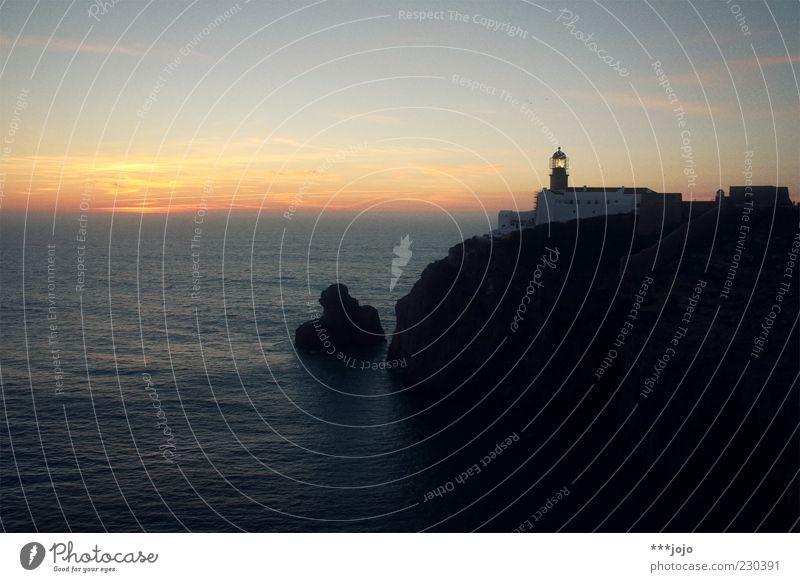 Nature Vacation & Travel Ocean Far-off places Coast Horizon Rock Illuminate Manmade structures Idyll Navigation Lighthouse Dusk Wanderlust Cliff Portugal