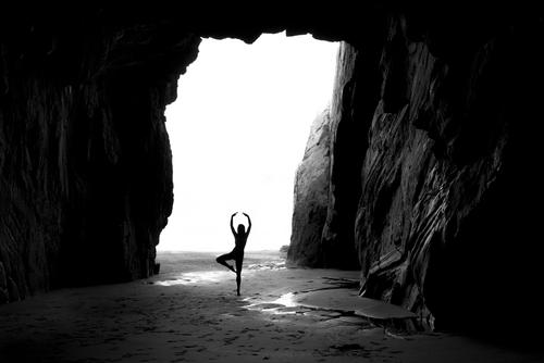 Dancing mood Feminine 1 Human being Landscape Water Summer Beautiful weather Rock Coast Beach Ocean Cave Movement Dance Large Cold Maritime Gray Black White
