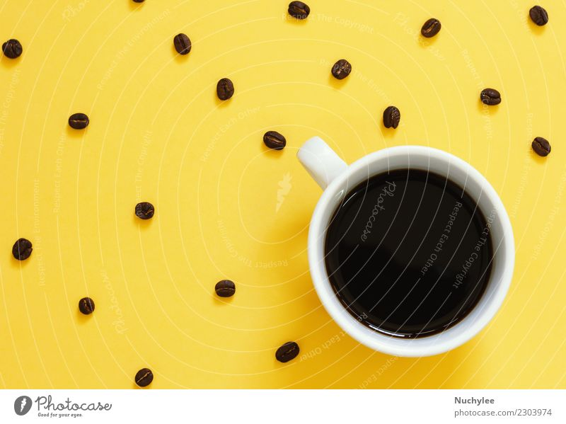 Top view of black coffee and coffee beans on yellow Coffee Espresso Lifestyle Style Design Table Simple Modern Yellow Colour Idea Creativity lay flat Minimal