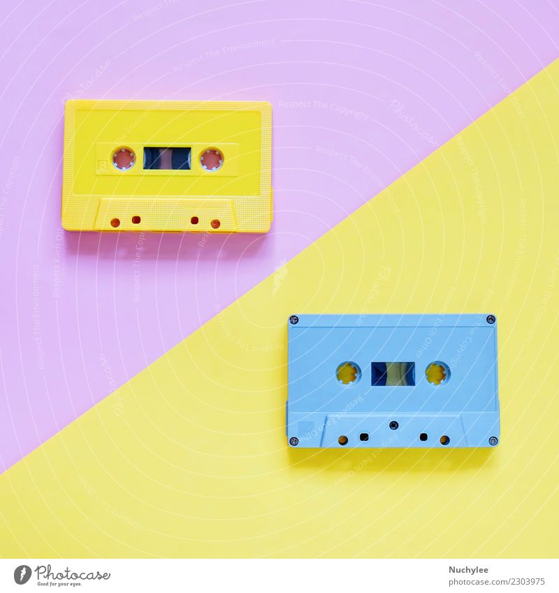 Retro cassette tapes on pastel color background Style Design Entertainment Music Media Plastic Old Listening Yellow Pink Black Colour Nostalgia Tape cassette