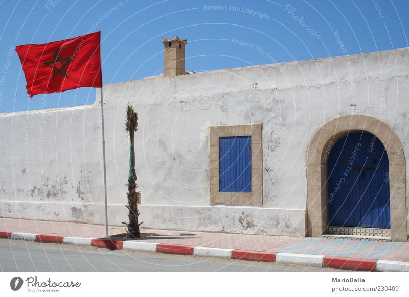 Morocco Cloudless sky Sunlight Wind Building Authentic Strong Blue Red Power Might Pride Energy Identity Calm Colour photo Exterior shot Star (Symbol)