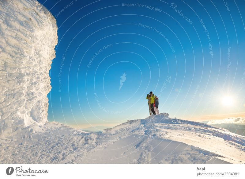 People man and woman on the top of the winter mountain Woman Human being Sky Nature Vacation & Travel Youth (Young adults) Man Young woman Blue Beautiful