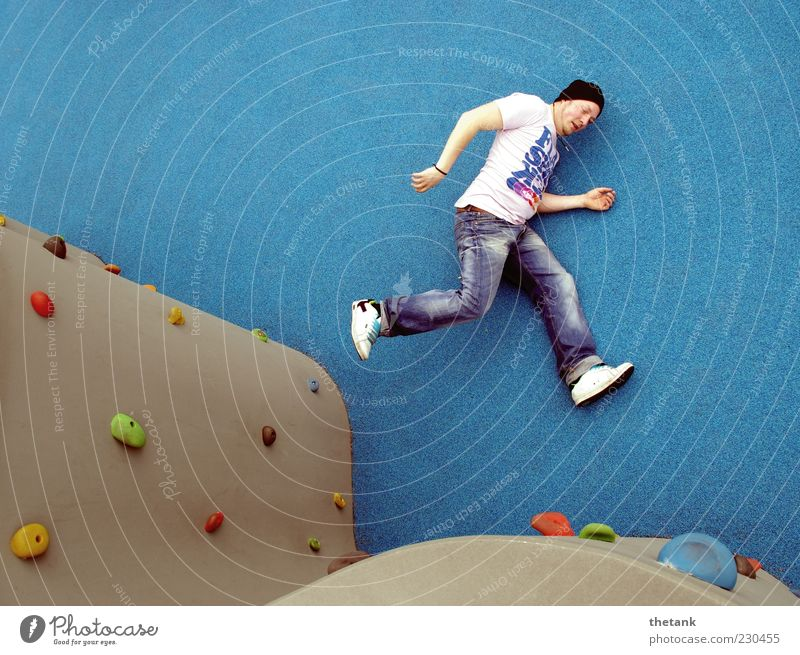 leap of courage Young man Youth (Young adults) 1 Human being 18 - 30 years Adults Wall (barrier) Wall (building) Jeans Lie Running Sports Jump Elegant Athletic