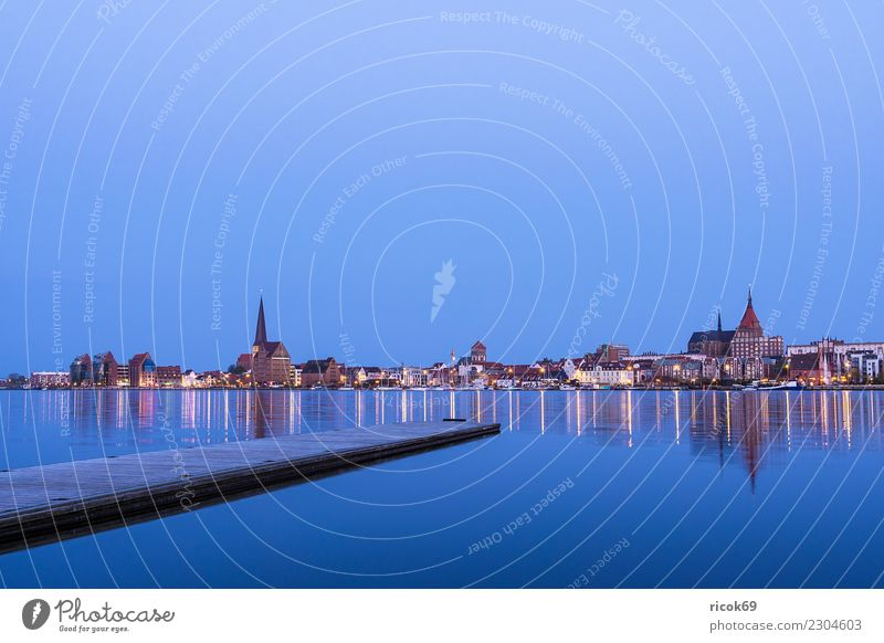View over the Warnow to the city of Rostock in the evening Relaxation Vacation & Travel Tourism House (Residential Structure) Nature Landscape Water River Town