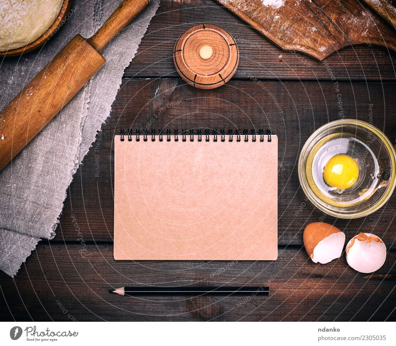 empty paper notebook with brown pages Dough Baked goods Bread Bowl Table Kitchen Paper Wood Fresh Natural Above Brown White Pencil recipe Menu Rolling pin Yeast