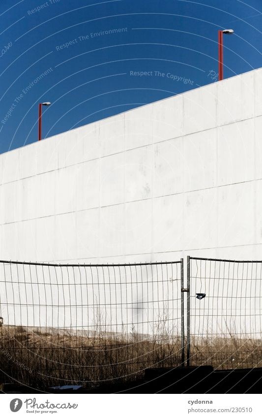 Calm Loneliness Meadow Wall (building) Architecture Wall (barrier) Lamp Facade Change Construction site Transience Protection Boredom Barrier Stagnating Cloudless sky