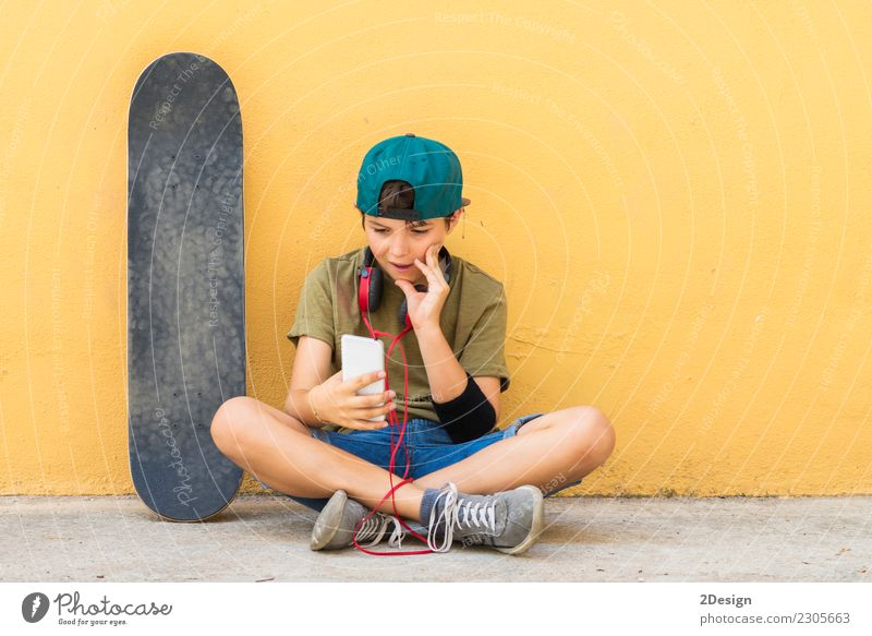 Portrait of a teenager sitting on the floor Lifestyle Beautiful Face Leisure and hobbies Freedom Music Telephone Headset PDA Technology Internet Human being