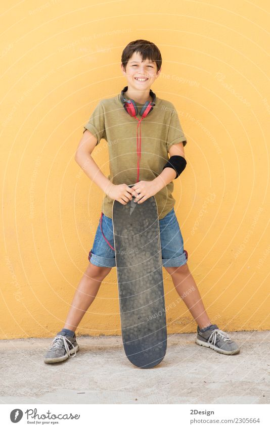 A Teen with skateboard on the city street Human being Man Colour Loneliness Joy Adults Street Lifestyle Emotions Sports Style Boy (child) Happy Fashion Infancy