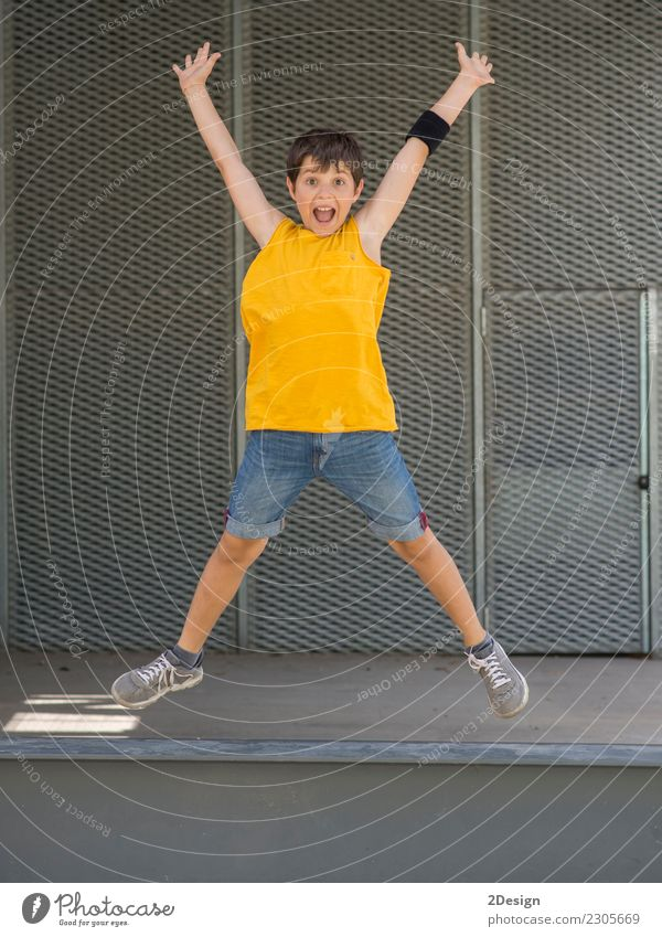 A young teen wearing yellow T-shirt and jumping Lifestyle Joy Freedom Summer Sports Success Child Boy (child) Man Adults Youth (Young adults) Arm Meadow