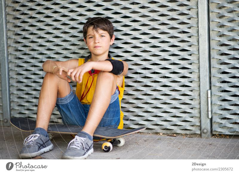 Casual dressed young teen skater outdoors portrait ( lifestyle ) Lifestyle Joy Relaxation Leisure and hobbies Summer Sports Child Human being Boy (child) Man