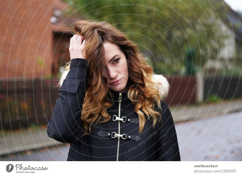 sad young woman on the street / winter depression Loneliness Sadness Meditative Winter Lifestyle Human being Young woman Woman Adults Town Street Jacket Coat