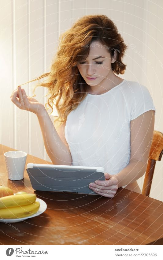 young woman using tablet computer at breakfast table Fruit Coffee Lifestyle Relaxation Leisure and hobbies Living or residing Flat (apartment) Table Kitchen