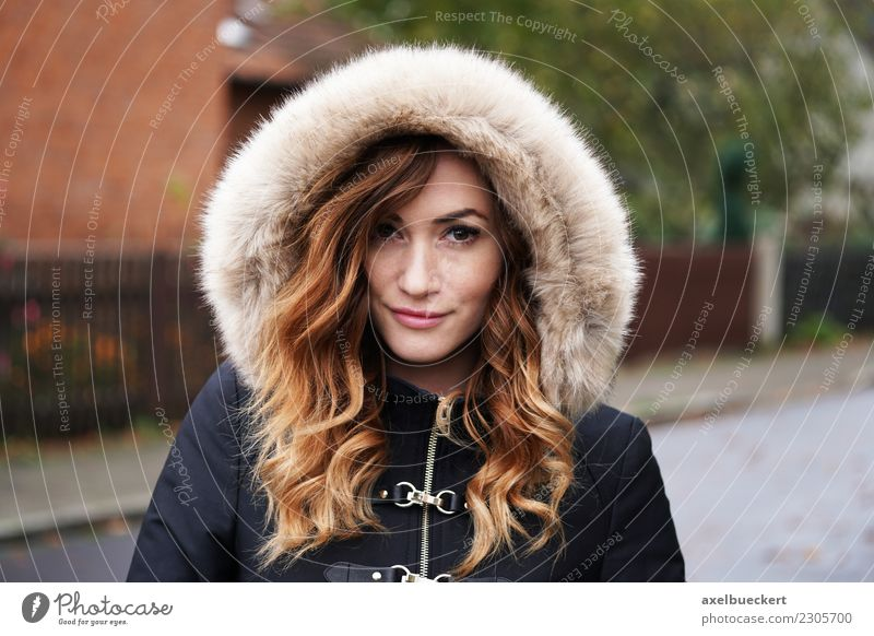 young woman in winter jacket Lifestyle Winter Human being Feminine Young woman Youth (Young adults) Woman Adults 1 18 - 30 years Autumn Weather Bad weather Town