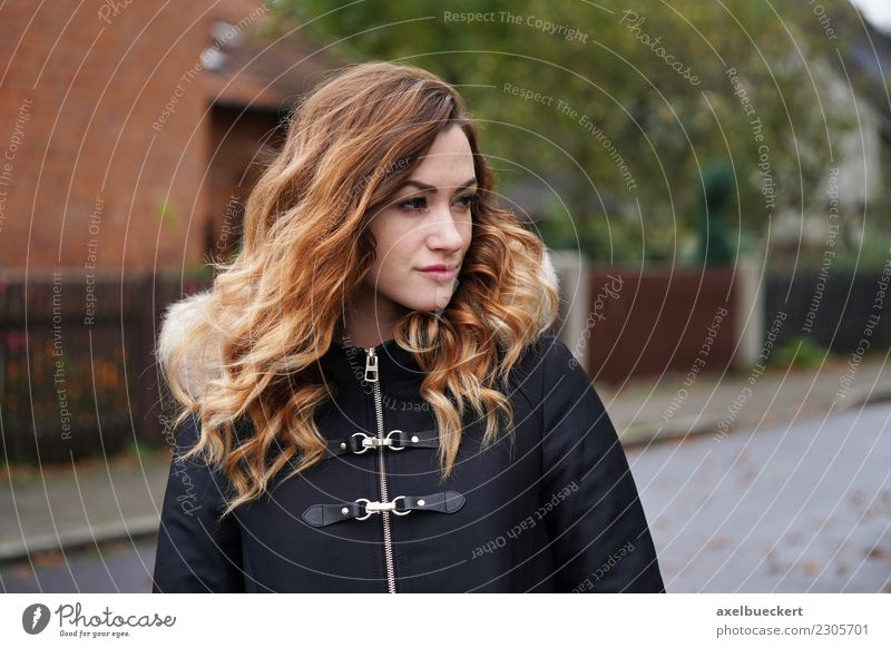 thoughtful young woman in the street Lifestyle Winter Human being Feminine Young woman Youth (Young adults) Woman Adults 1 18 - 30 years Town Street Jacket Coat