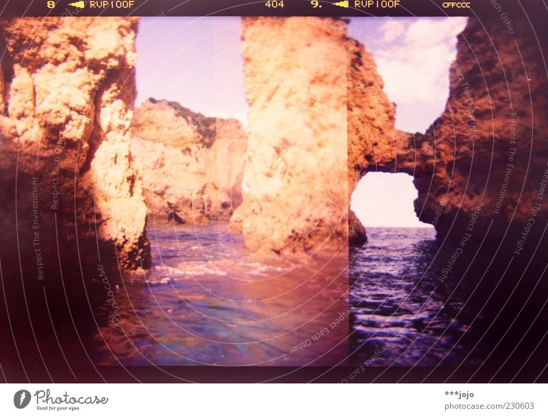 Ocean Stone Rock Digits and numbers Bizarre Frame Double exposure Cliff Surface of water Portugal Rock arch Atlantic Ocean Cervice Lagos