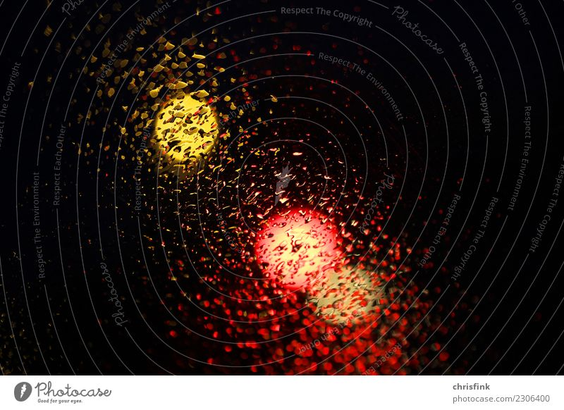 Traffic light behind disc with drops Drops of water Sky Rain Road traffic Motoring Traffic accident Driving Wet Gold Orange Black Fear Threat Colour photo
