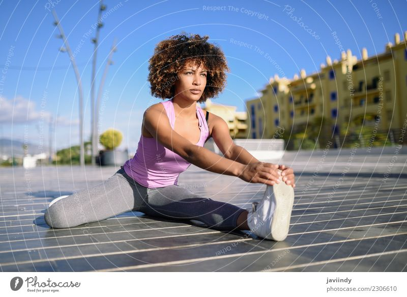Young black woman doing stretching after running outdoors Lifestyle Beautiful Hair and hairstyles Wellness Leisure and hobbies Sports Human being Young woman