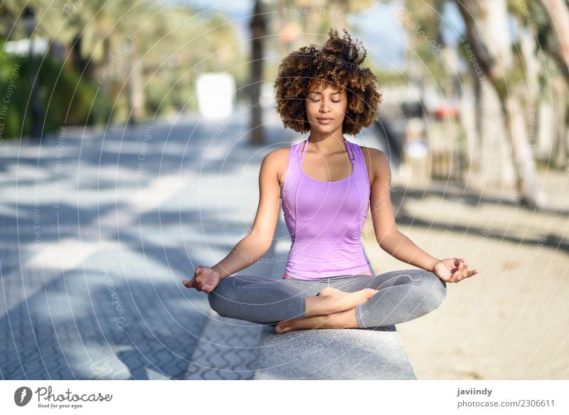 Black womab doing yoga in the beach with eyes closed Woman Human being Youth (Young adults) Young woman Beautiful Relaxation 18 - 30 years Adults Lifestyle