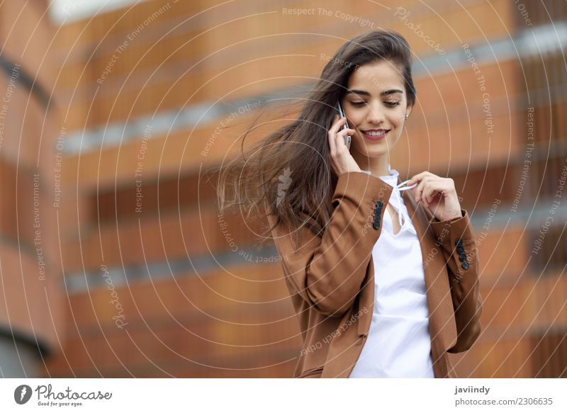 Young businesswoman talking with a smartphone Beautiful Hair and hairstyles Workplace Business Telephone PDA Technology Human being Feminine Young woman