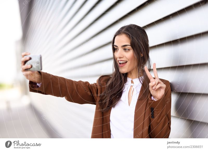 Young woman taking selfie photograph with smartphone Beautiful Hair and hairstyles Business Telephone PDA Technology Human being Youth (Young adults) Woman