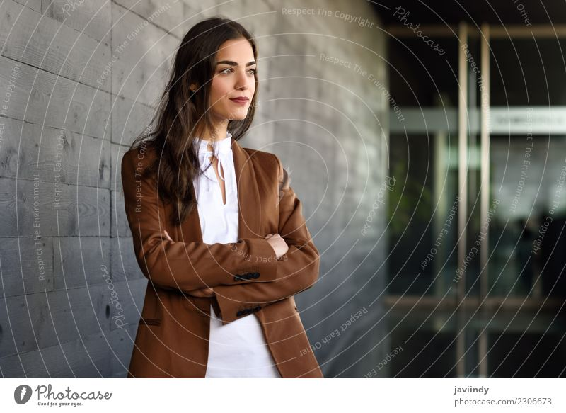 Young businesswoman standing outside of office building. Woman Human being Youth (Young adults) Young woman Beautiful 18 - 30 years Adults Feminine Building