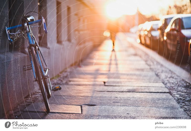 17 Summer Human being Beautiful weather Town House (Residential Structure) Wall (barrier) Wall (building) Pedestrian Sidewalk Bicycle Walking Gold Anticipation