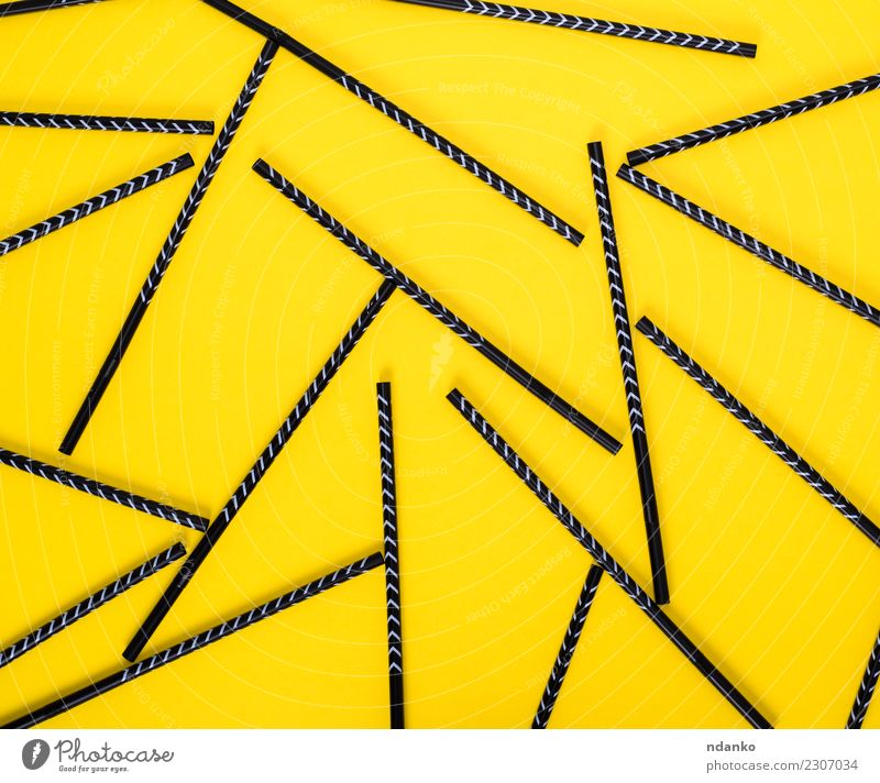 black cocktail straws Tube Plastic Bright Above Soft Yellow Black Colour coctail background party drink circle Colour photo Close-up Detail