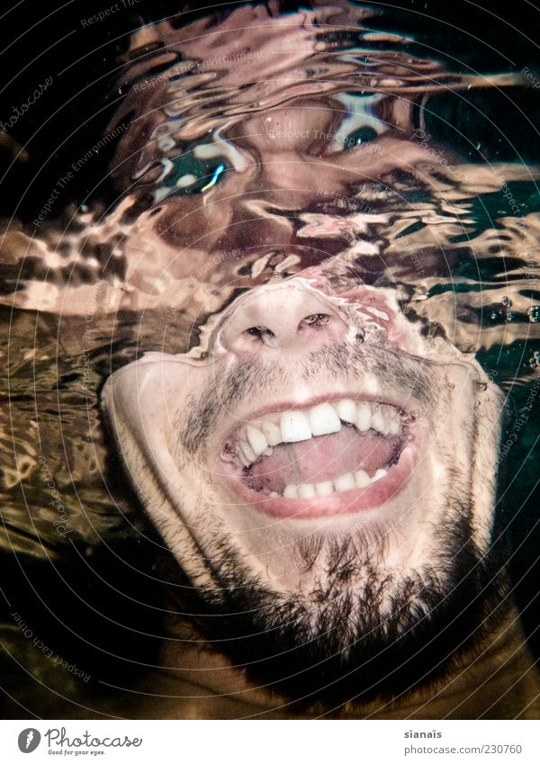 looking deep into the glass Human being Masculine Young man Youth (Young adults) Man Adults Head 1 Water Joy Joie de vivre (Vitality) Distorted Laughter Madness