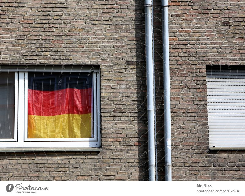Red Window Black Wall (building) Building Wall (barrier) Germany Facade City life Living or residing Flat (apartment) Decoration Gold Gloomy German Flag