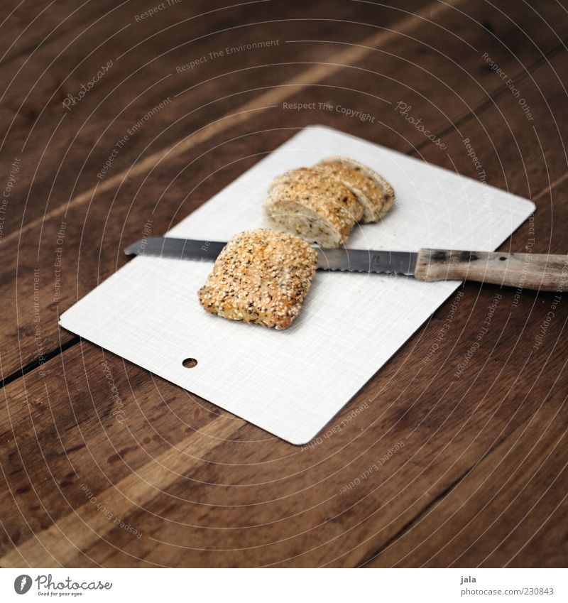 buns Food Roll Nutrition Organic produce Vegetarian diet Knives Wood Fresh Healthy Delicious Chopping board bread knife Table Slice Colour photo Interior shot