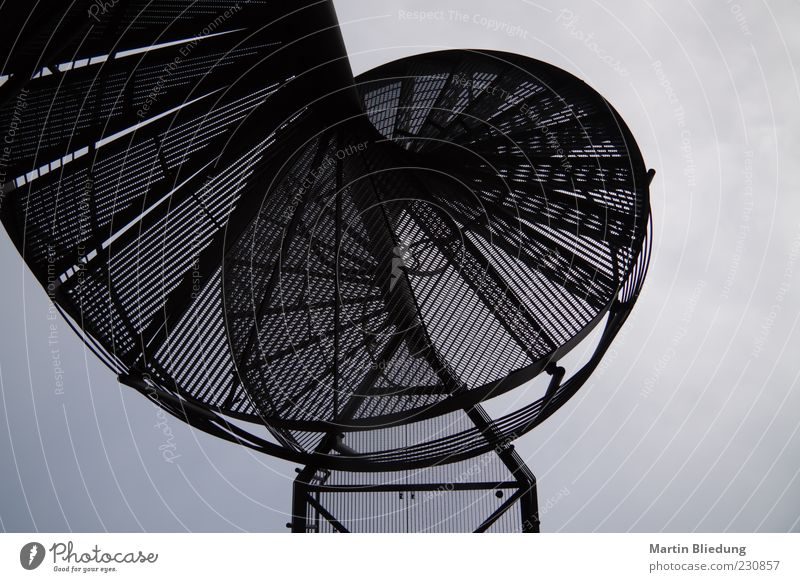 Black Dark Metal Exceptional Stairs Uniqueness Round Steel Grating Curved Winding staircase Black & white photo Metal steps