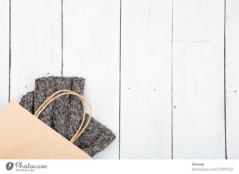 knitted winter sweater on wooden background Winter Warmth Lifestyle Autumn Wood Style Fashion Gray Table Shopping Clothing Industry Soft Tradition Desk