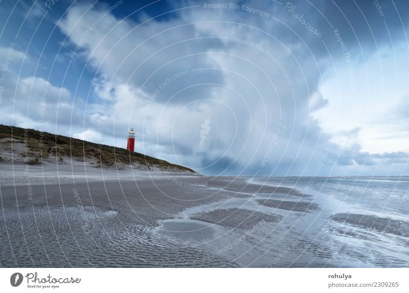windy stormy morning on north sea coast with red lighthouse Vacation & Travel Beach Island Nature Landscape Sand Sky Clouds Weather Storm Coast North Sea