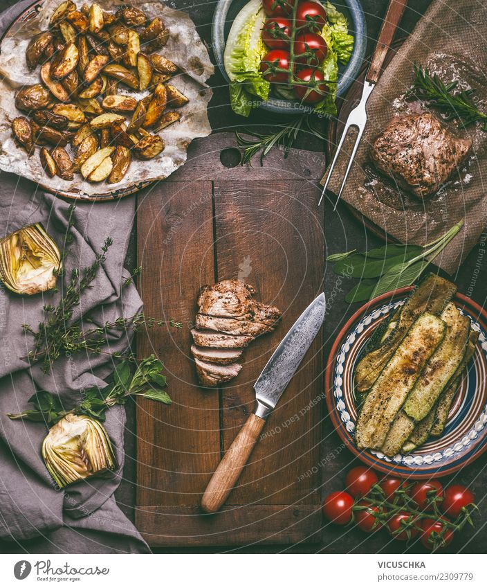 Roasted pork and kitchen knife on cutting board Food Meat Vegetable Lettuce Salad Herbs and spices Nutrition Lunch Dinner Organic produce Crockery Knives Style