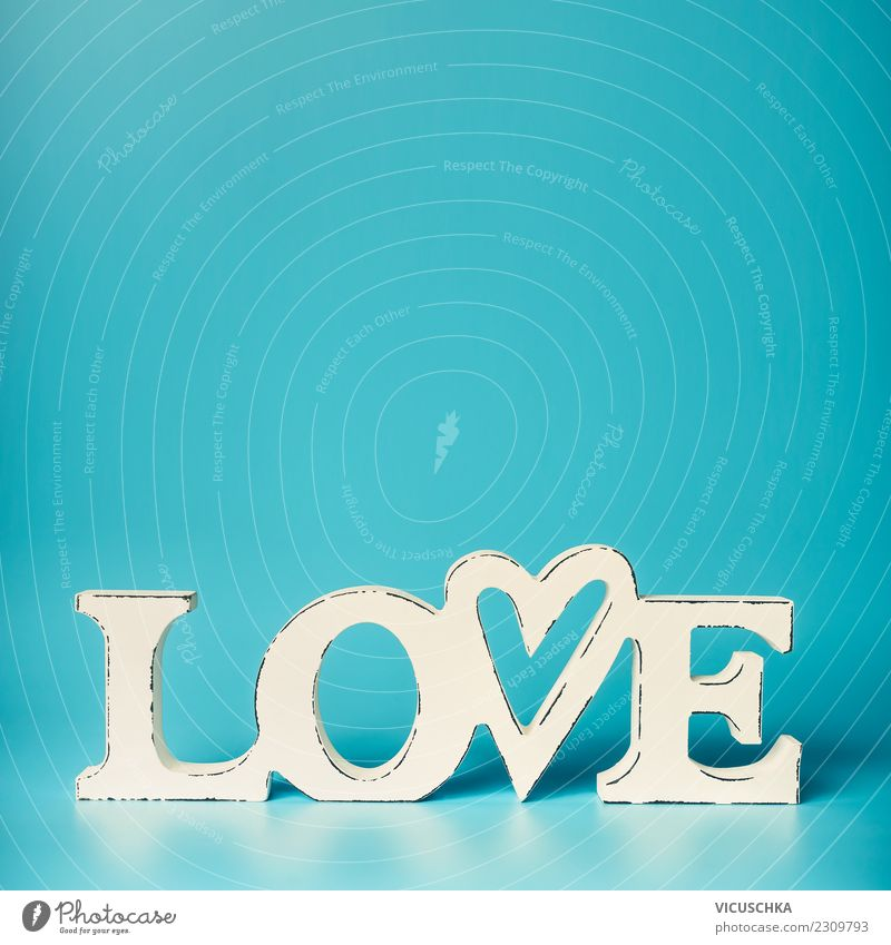 Word Love On Turquoise Blue Background A Royalty Free Stock Photo