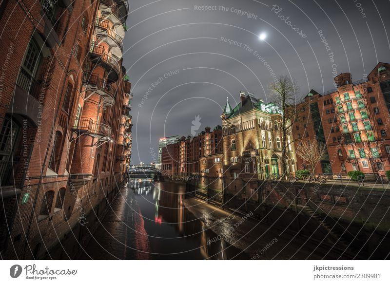 Speicherstadt Hamburg moated castle at night Europe Germany Old warehouse district World heritage Harbour Night Night shot Wide angle Clouds Dark Handrail