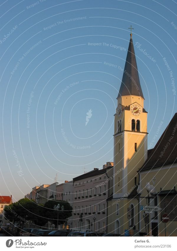 Church in the evening House of worship Religion and faith Evening mill village Church spire Pointed roof Christian cross Church tower clock Housefront Blue sky