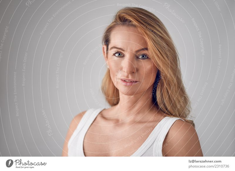 Attractive blond woman with parted lips Skin Face Woman Adults 1 Human being 45 - 60 years Blonde Fresh Natural Self-confident Middle-aged Head and shoulders