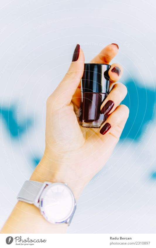 Woman Hand Holding A Bottle Of Red Nail Polish Lifestyle Elegant Style Design Beautiful Manicure Make-up Nail polish Wellness Clock Human being Feminine