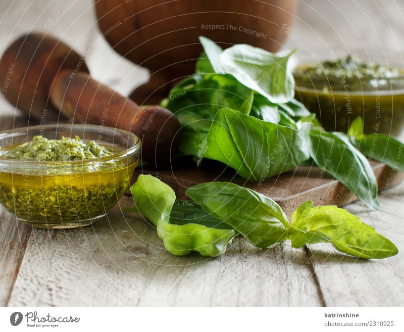 Pesto sauce and fresh basil on a wooden table Vegetarian diet Bowl Gastronomy Leaf Fresh Natural Green Tradition Aromatic Basil pesto condiment cooking dressing