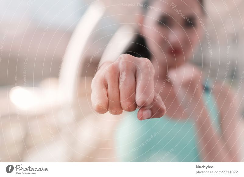 Woman clenched fist ready to punch close up Lifestyle Style Body Face Sports Martial arts Human being Adults Hand Fitness Athletic Strong Anger White Power