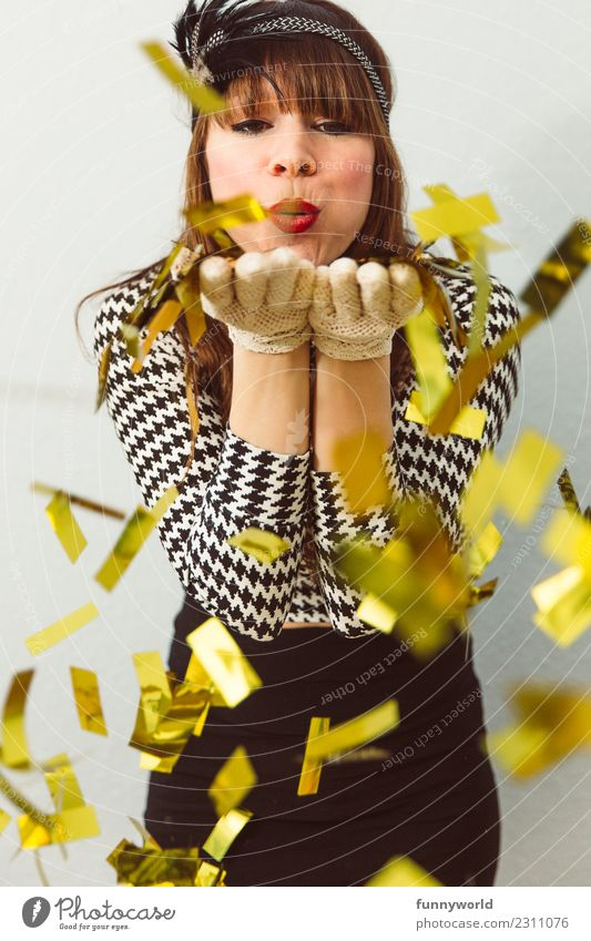 Woman blowing golden confetti into camera Human being Feminine Adults 1 Throw Beautiful Eroticism Blow Kissing Pout Disguised Glitter Confetti Gold Happiness