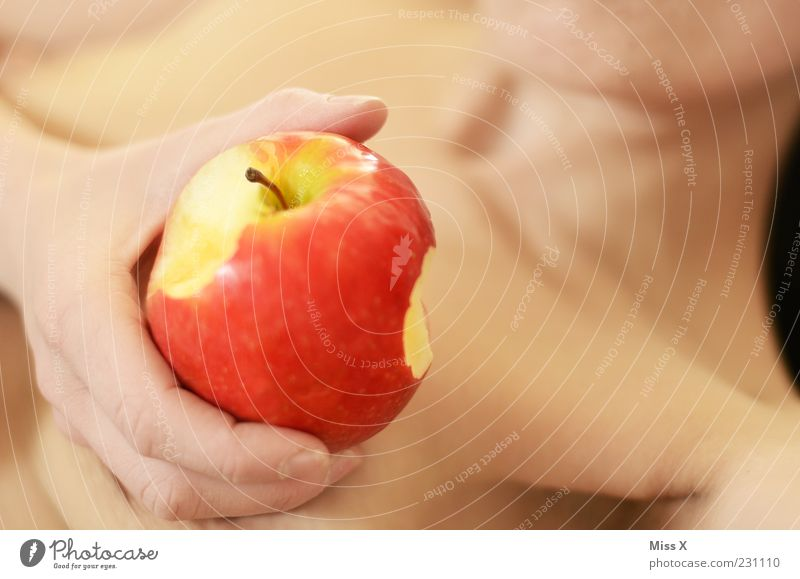 Woman Human being Hand Adults Feminine Nutrition Food Eating Fruit Lie Sweet Symbols and metaphors Apple Chest Delicious Lust