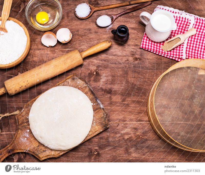 yeast dough made from white wheat flour Dough Baked goods Bread Roll Bowl Spoon Table Kitchen Sieve Wood Eating Fresh Natural Brown White Rolling pin Yeast
