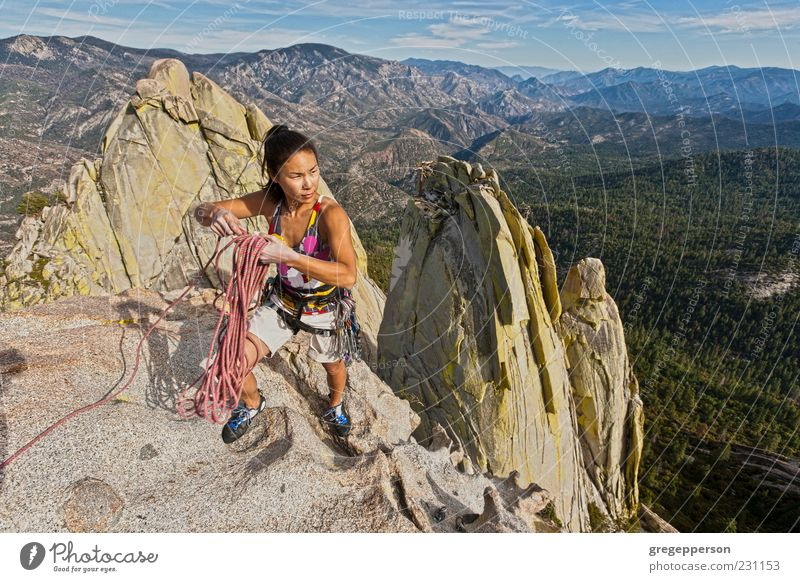 Rock climber clinging to a cliff. Human being Nature Youth (Young adults) Adults Sports Power Tall Adventure Rope Success 18 - 30 years Young woman Climbing
