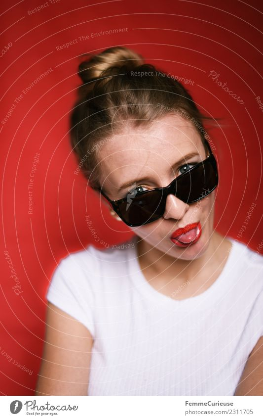 Young woman with sunglasses stretching out tongue Style Feminine Youth (Young adults) Woman Adults 1 Human being 18 - 30 years Beautiful Brash Cool (slang)
