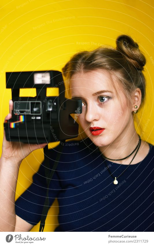 Young woman taking pictures with an instant camera Lifestyle Elegant Style Feminine Youth (Young adults) Woman Adults 1 Human being 18 - 30 years Creativity