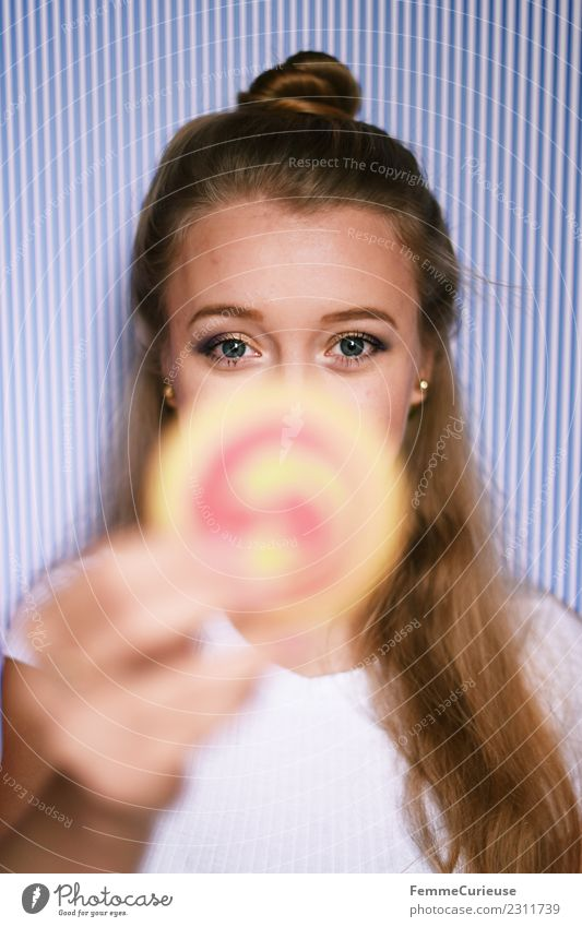 Young blonde girl holding a cookie in her hand Feminine Young woman Youth (Young adults) Woman Adults 1 Human being 18 - 30 years Joy Cookie Candy Baked goods
