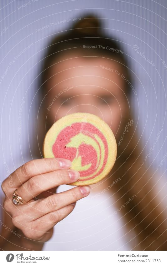 Young woman showing cookie into the camera Food Youth (Young adults) Woman Adults 1 Human being 18 - 30 years To enjoy Butter cookie Baked goods Candy Dough