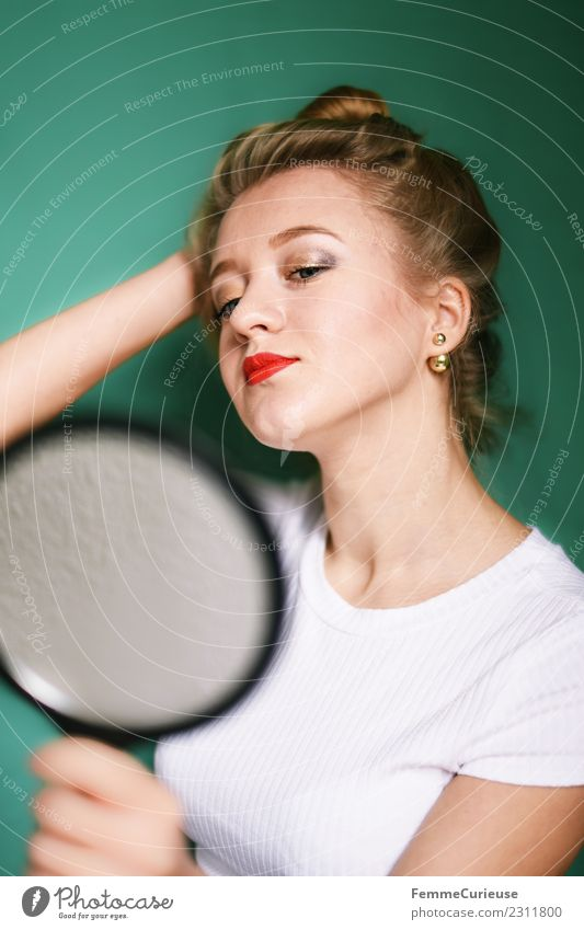 Blonde girl looking at herself in a mirror Feminine Young woman Youth (Young adults) Woman Adults 1 Human being 18 - 30 years Beautiful Mirror Mirror image